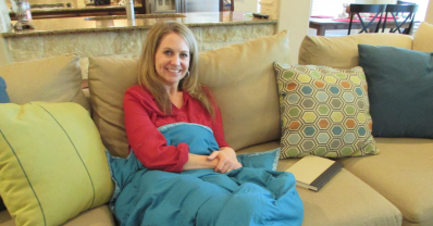 woman using a weighted blanket