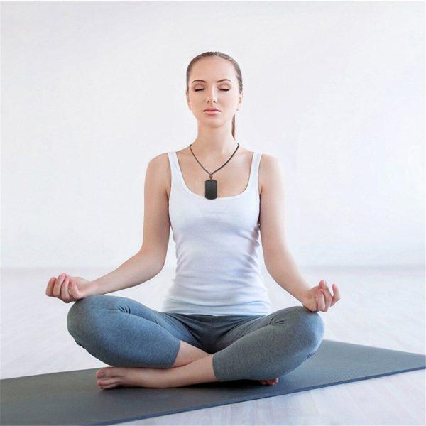 Black Quantum Pendant Scalar Energy Anti EMF Necklace Rectangular Style Worn On Female Meditating Model